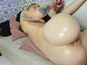 Blonde Brit wanked with a phat oiled dildo